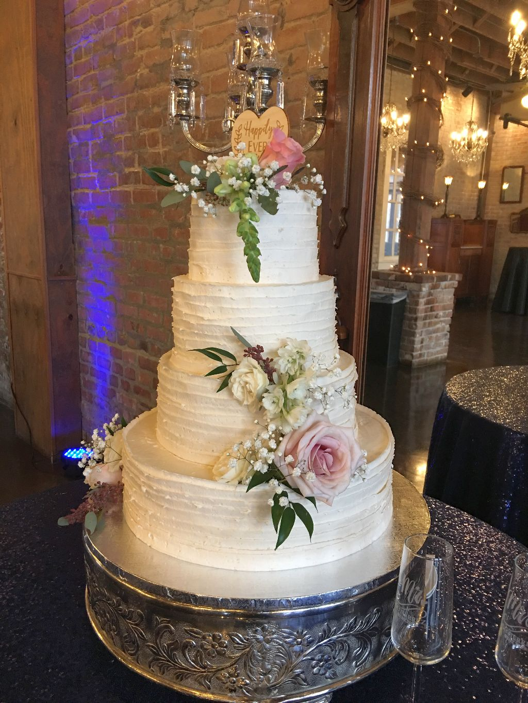 4 tier white choclate wedding cake